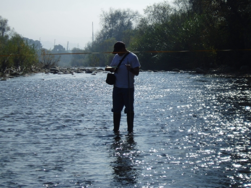 Tommy Liddell measuring flow at the Ventura River Mass Emission Monitoring Site (Jan. 2006)